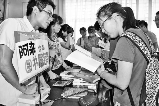 中国新闻出版广电报报道――海南书香节:书香与花香媲美